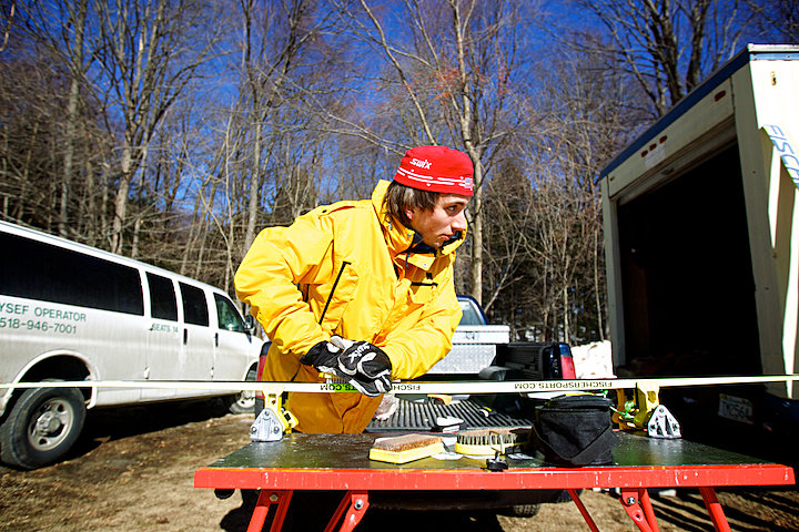 Brattleboro's own Spencer Knickerbocker prepares his skis with a fresh coat of wax.  Spencer finished 5th in the Junior I category.