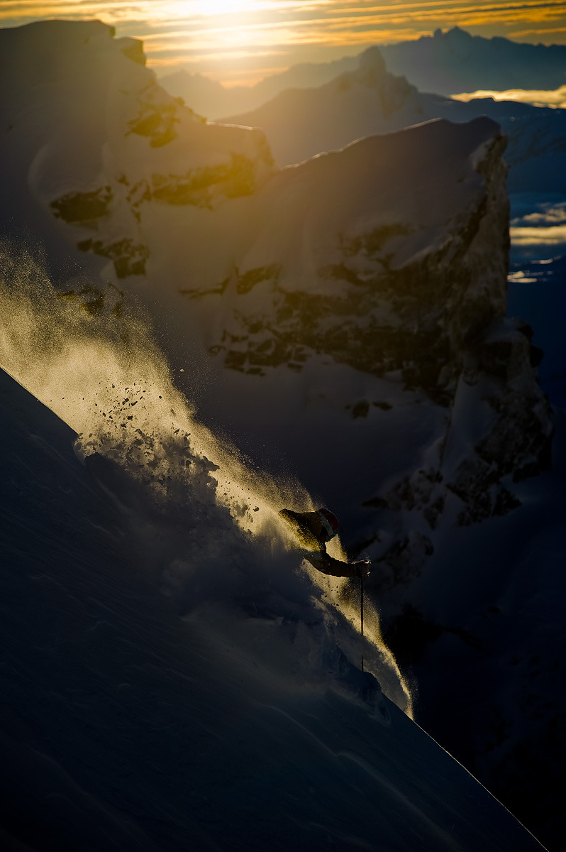 After having caught the last t-bar of a cool December day, followed by a short hike into Blackcomb's backcountry, Chad Sayers wraps things up on a tasty spine. In the distance, the iconic peaks of Black Tusk and Tantalus reach for the last rays of sun on one of the shortest days of the year.