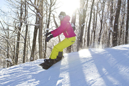 A snowboarder carves fresh turns at Windham Mountain. Photo Courtesy of Windham Mountain.