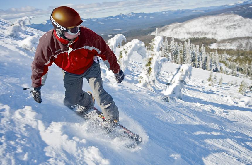 A snowboarder rides Hoodoo. Photo courtesy of Hoodoo Ski Area.