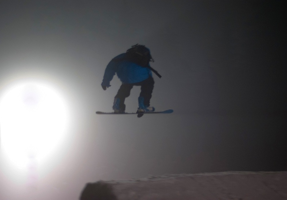 A snowboarder gets air under Grouse Mountain's night lights. Photo by Twinned Chimera/Flickr. - ©Twinned Chimera/Flickr