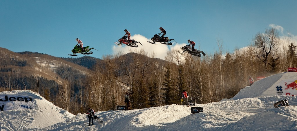 Snocross racers gapping over 100 feet.