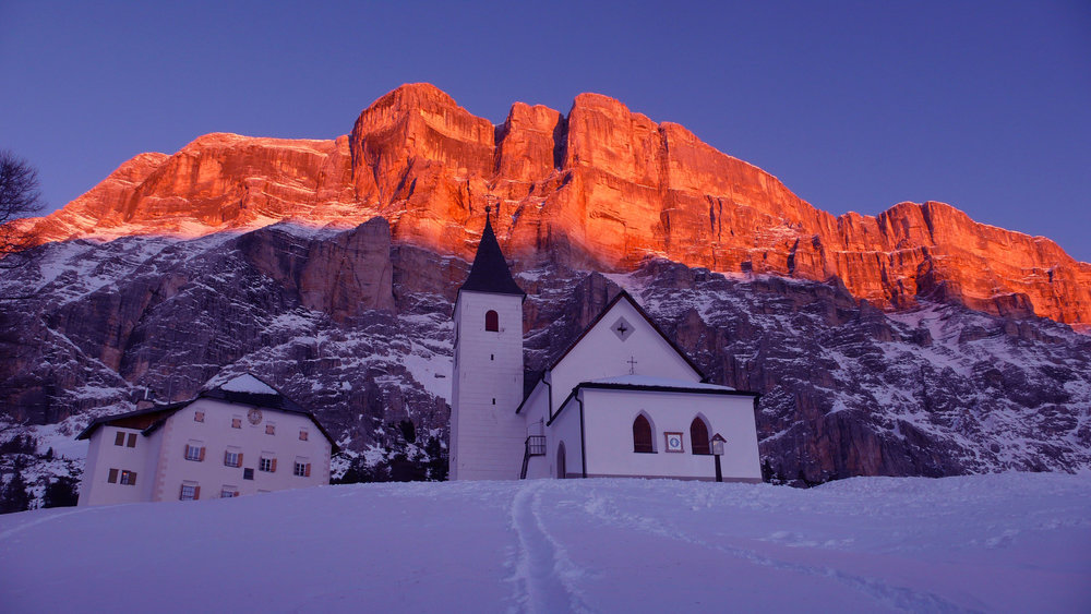 The pink glow of the Dolomites at sunset in Alta Badia