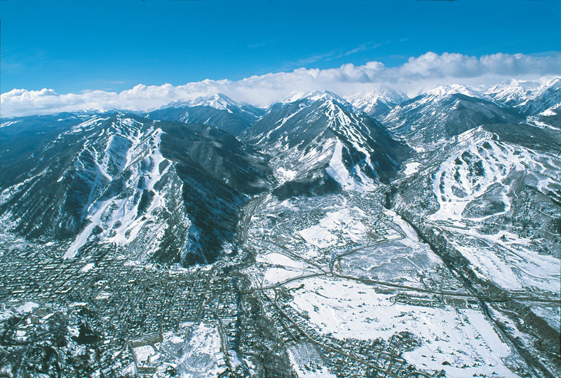 Aerial view of Aspen Mountain, Aspen Highlands and Buttermilk (left to right).Photographer-David Perry