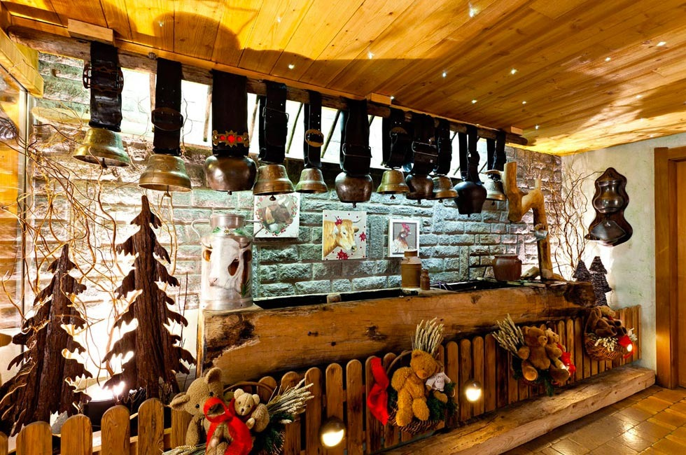 Cow bells on the wall at restaurant Le Saint Laurent in Hôtel Labrador in Les Gets