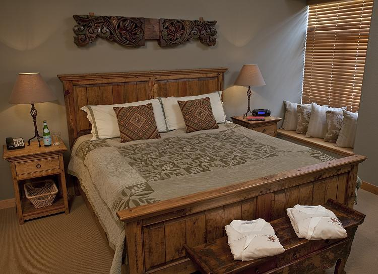 The bedroom of a 1 bedroom/1 bathroom condominium at the Edelweiss Lodge & Spa.