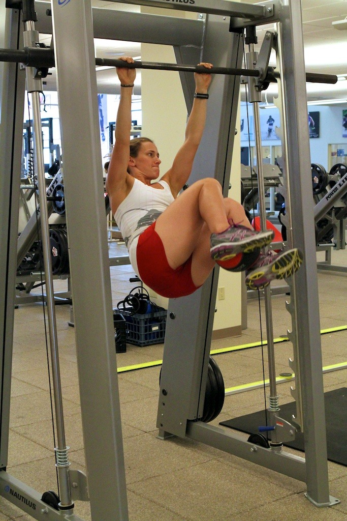 Heather McPhie demonstrates how she stays healthy as the ski season comes an end with Weighted Hanging Leg Raises with Twist.
