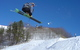 A skier gets big air off a jump in Caberfae Peaks, Michigan