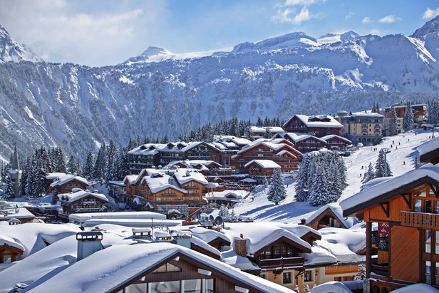 Snow-clad luxury chalets in Courchevel, France - ©Courchevel Tourist Office