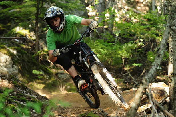 A mountain biker explores the singletrack around Creekside in Whistler. - ©Steve Rogers/Tourism Whistler