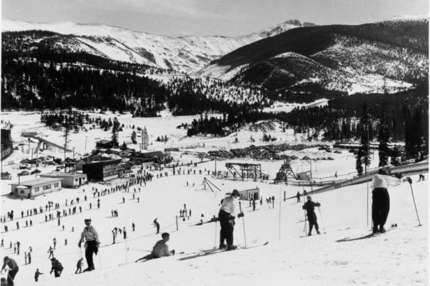 Skiers wear leather ski boots and wooden skis at Winter Park in its early years of the 1940s. - ©Winter Park Resort