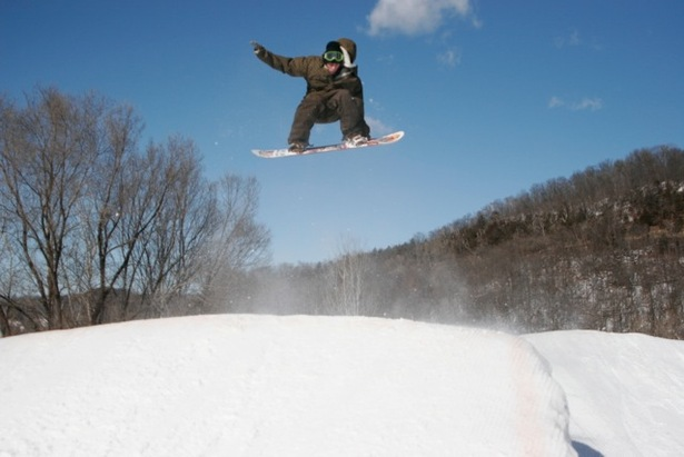 Snowboarder catching air at Mt. LaCrosse.