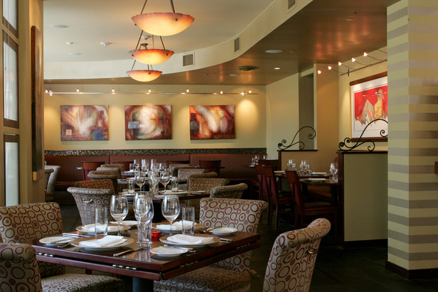 The intimate dining room at Kelly Liken features fantastic lighting and artwork not to mention Kelly's world-class cuisine.  - ©Kelly Liken