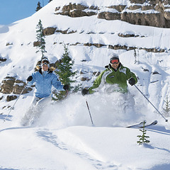 Two skiers at Aspen Highlands