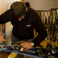 Skiplan's in-house tech setting the bindings to the correct weight