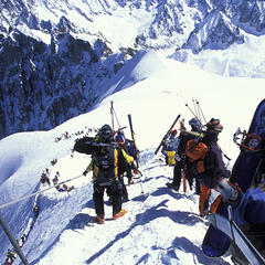 Walking down the ridge of the Aiguille du Midi at the start of the Vallee Blanche, Chamonix