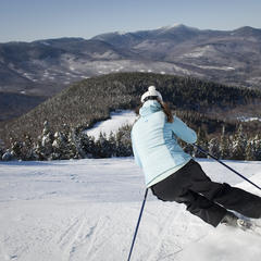 A skier admires beautiful views while cruising down the slopes. Photo Courtesy of Sunday River.