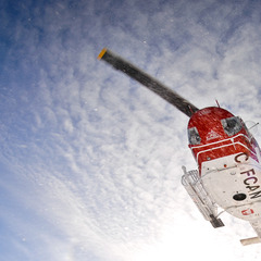 The chopper takes off with Tyax Lodge Heli-Skiing.