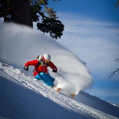 Hitting her mark perfectly, Amie catches the early morning light at Squaw Valley Ski Resort.  - ©Jeff Engerbretson