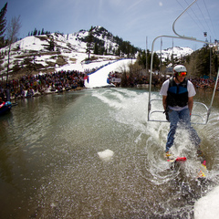 A skier/chair lift crosses the pond with no problem at Cushing Crossing 2012 at Squaw Valley.
