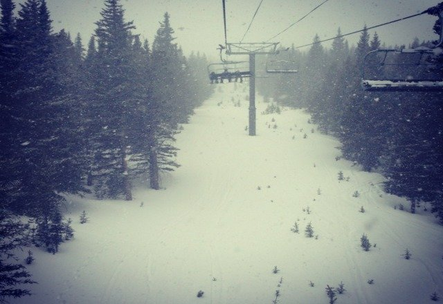 End of the day at breck. still dumping snow. spring skiing in powder? i think so.