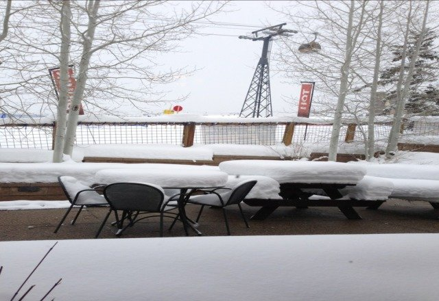 more than a foot of snow on these tables at the base near the gondola