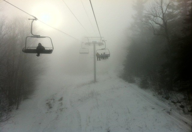 a little slushy. warm with a little wind an thin snow in places but fairly good. foggy.