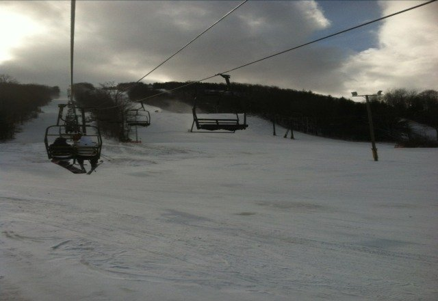 Here now. Base took major hit from rain. Where they are blowing snow it's ok but everywhere else it's Ice and rocks. Despite Kregger sayin on ski hotline that the park would be open this afternoon it is not. All 3 parks are closed. They also reported lifts 5 and 4 would be running however they are not