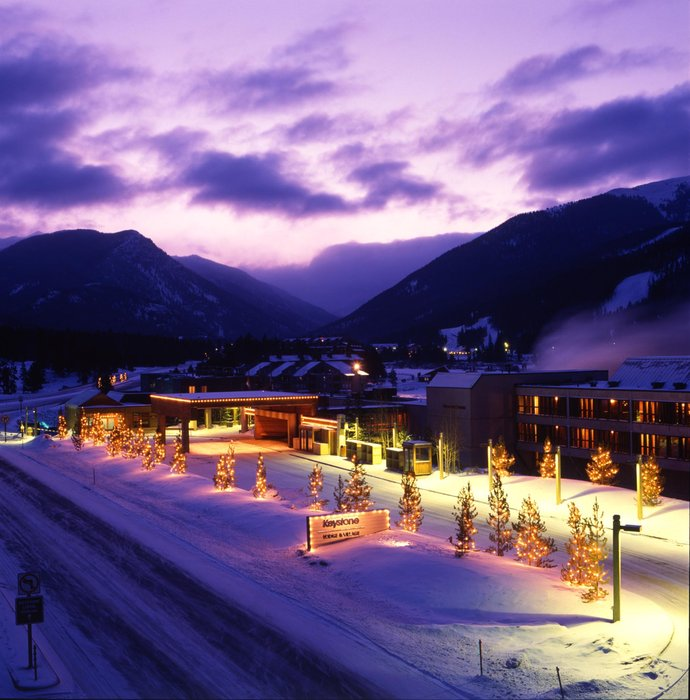 Exterior of Keystone's Lodge hotel at night in the winter.