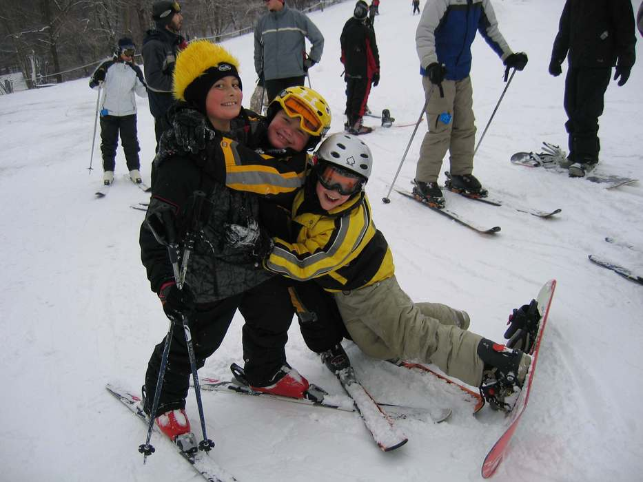 Friends on slope of Swiss Valley