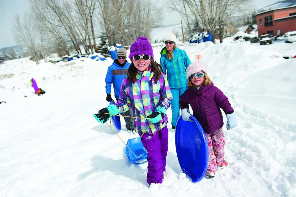 Sledding in Crested Butte is a family affair. - © Courtesy of Crested Butte Mountain Resort
