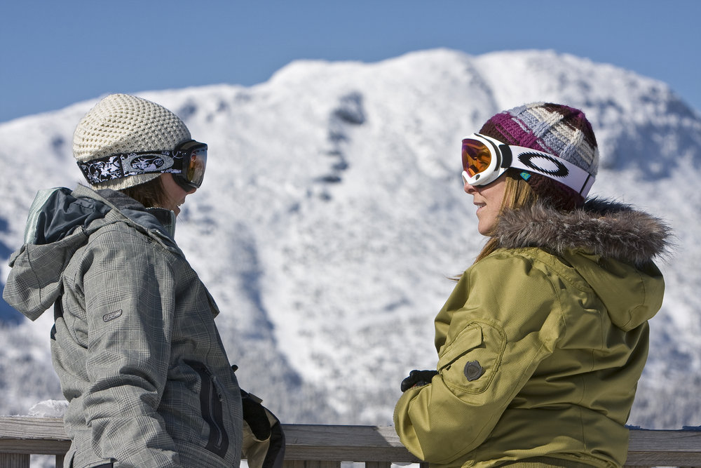 Two women take in the scenic view at Stowe, Vermont