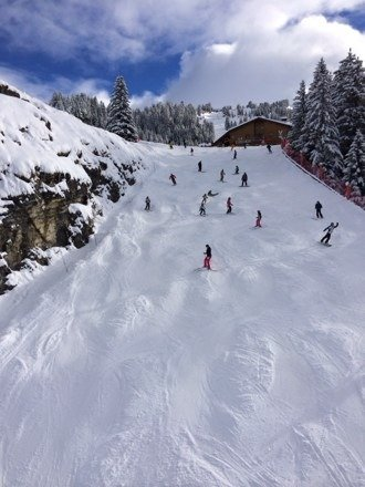 Plenty of snow. Great off piste skiing! This is one of the red runs with a few moguls!
