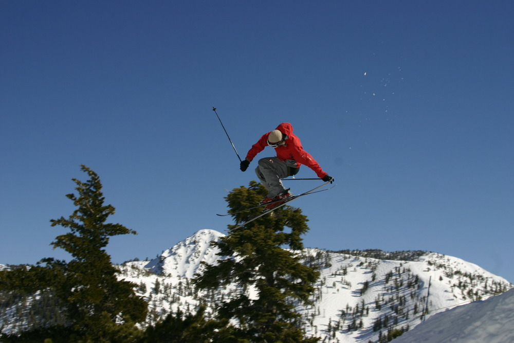 A skier gets some air in the half-pipe in the terrain park at Mt. Baldy Ski Resort, California