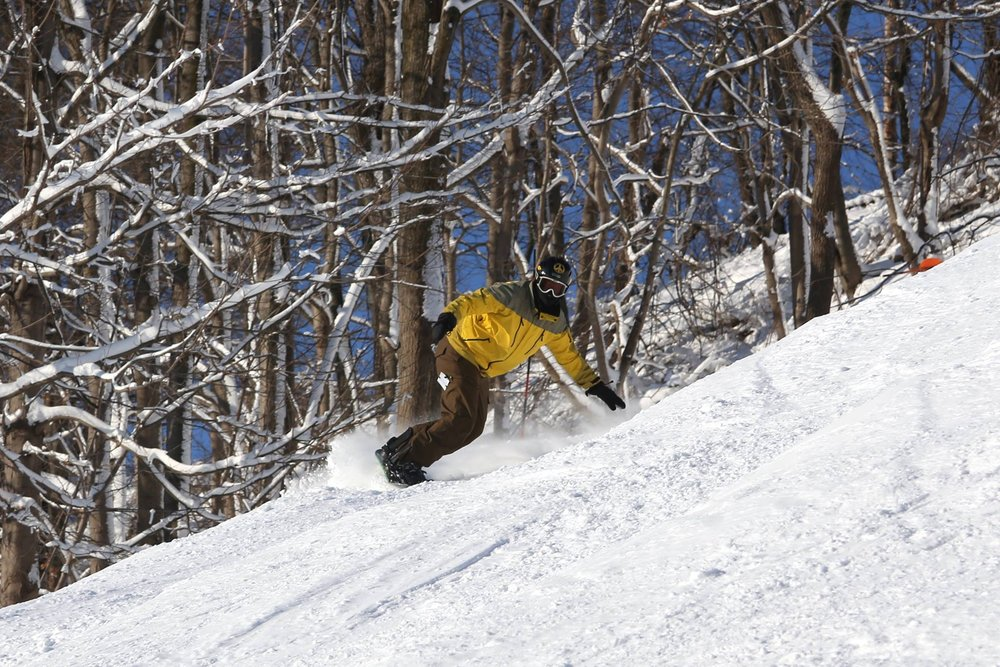 A snowboarder carves some fresh snow at Liberty. - © Liberty Mountain Resort
