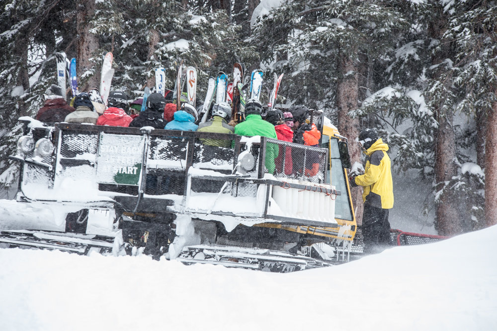 Let the snowcat do the work as you make your way to the top of Highland Bowl. - © Liam Doran