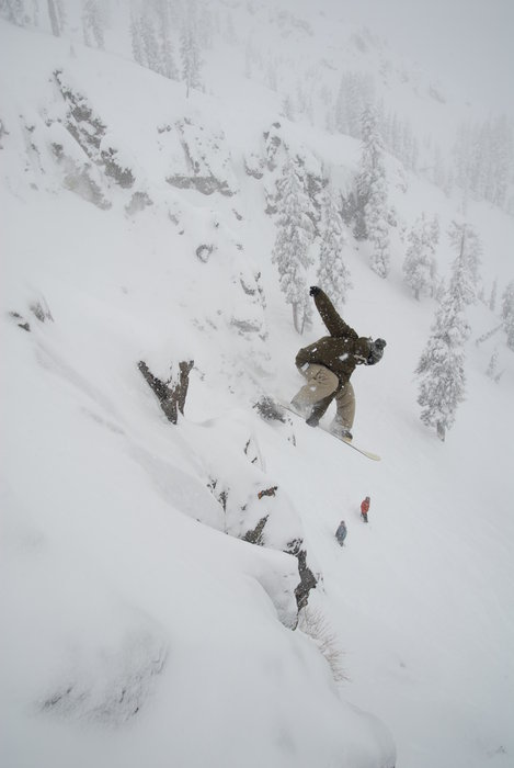 Snowboarder in powder drop
