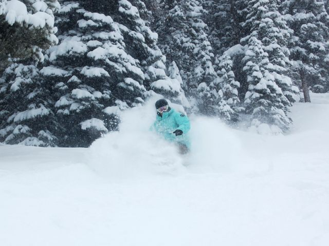 A skier enjoys 14 inches of fresh powder at Winter Park, CO, Dec. 4, 2008.