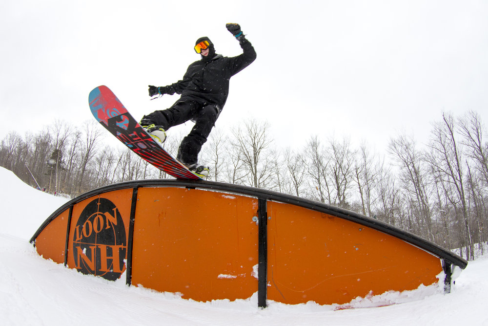 A rider slides a rail in the nearly mile-long Loon Mountain Park.  - © Gus Noffke