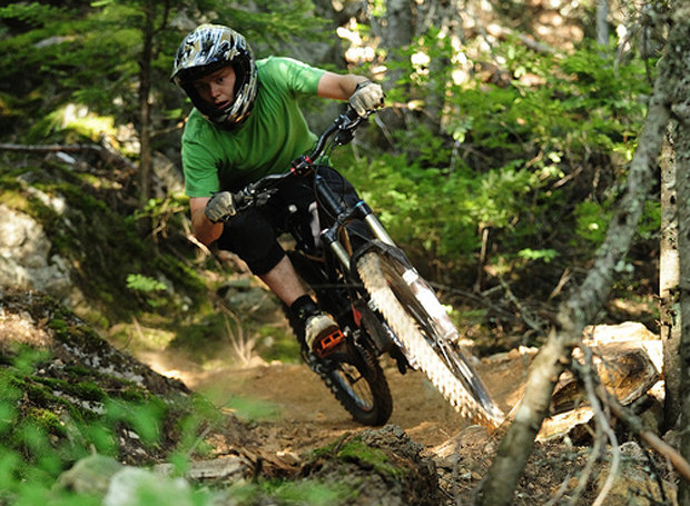 A mountain biker explores the singletrack around Creekside in Whistler. - © Steve Rogers/Tourism Whistler