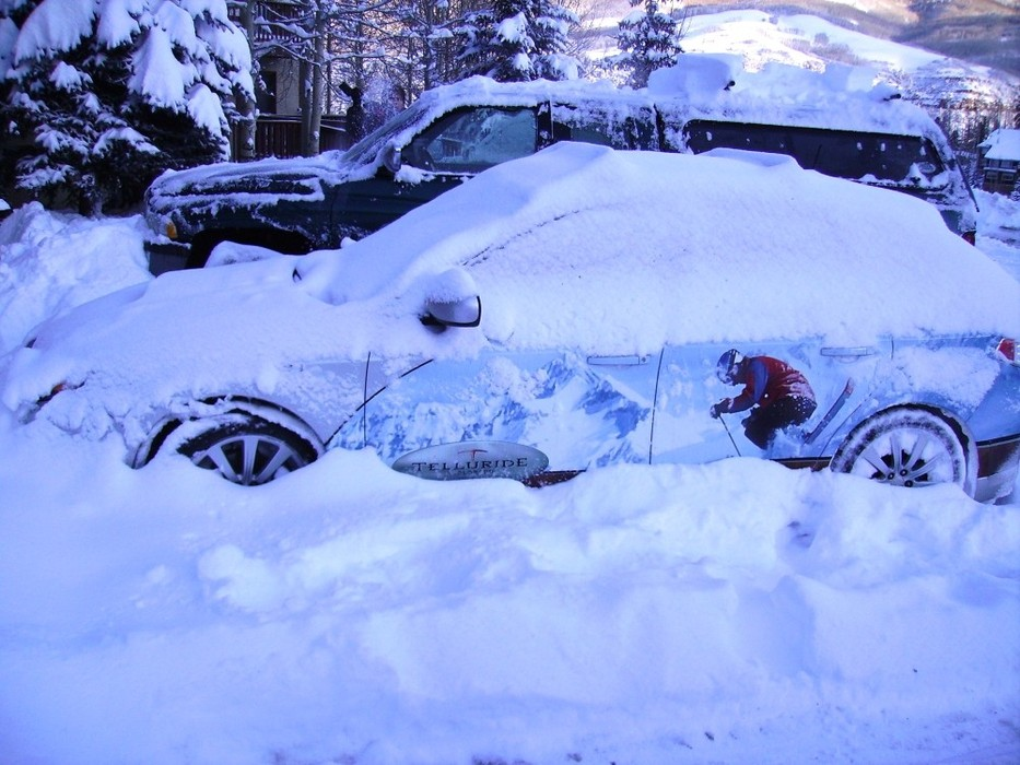 Car covered in snow at Telluride, CO.