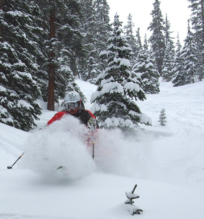 Loveland skier in deep powder.