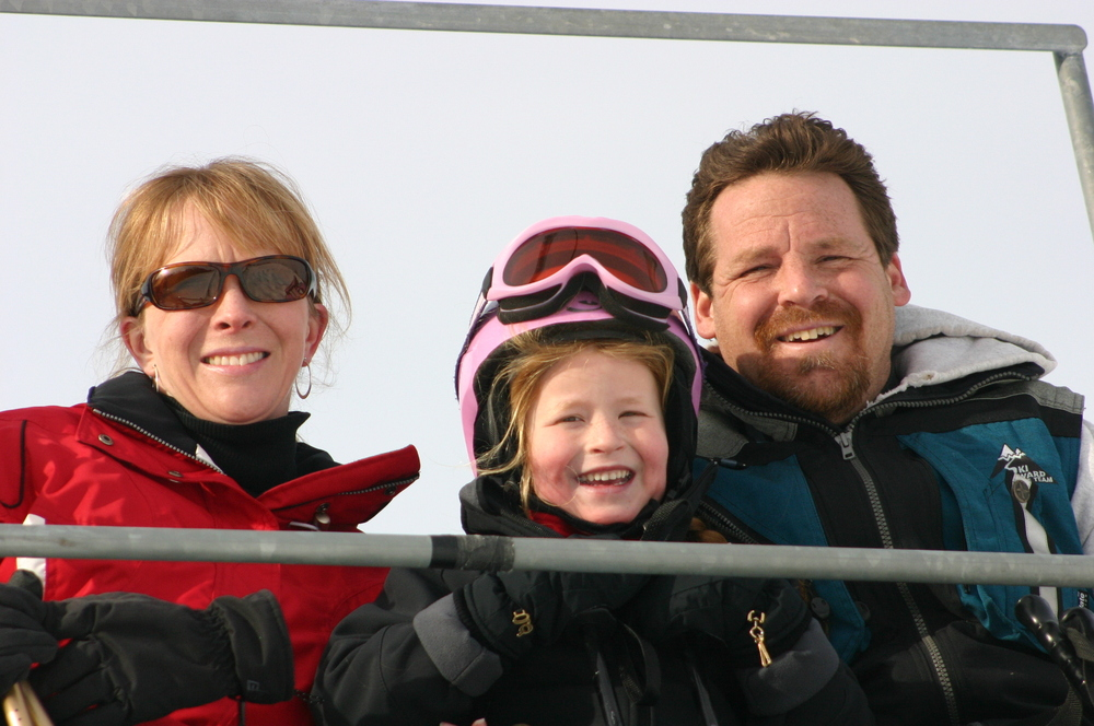 A family rides the chairlift at Ski Ward, MA