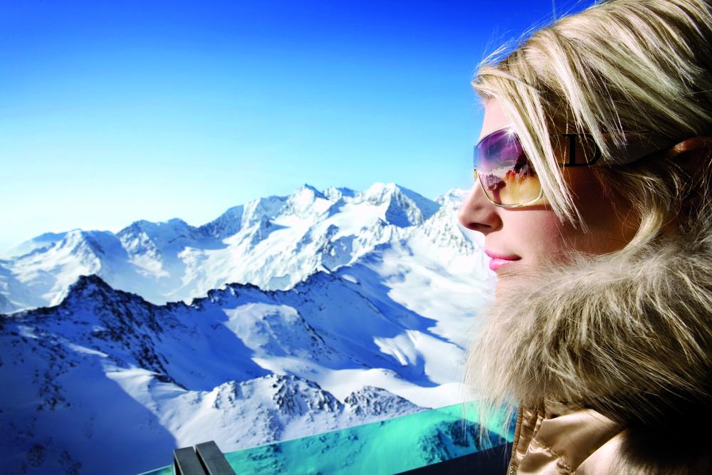 A woman surveying Obergurgl, AUT