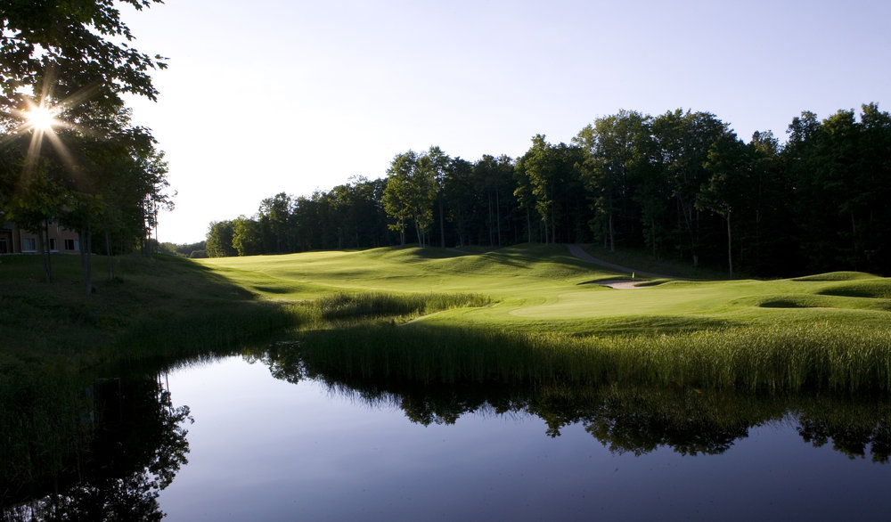 Golf course with water feature at Shanty Creek