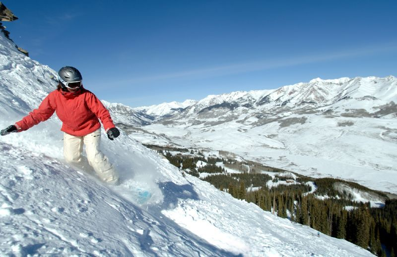A snowboarder takes an extreme run down the mountain in Crested Butte, Colorado