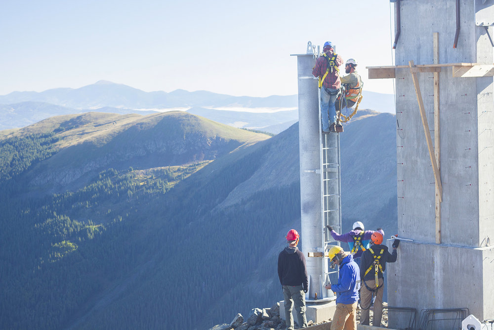 Crews install towers for the new lift up Kachina Peak at Taos for the 2014-15 ski season. - © Taos