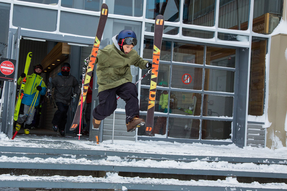 A young skier shoots out the gondola building doors in excitement for first run of the year at Whistler Blackcomb. - © Mitch Winton/Coast Mountain Photography