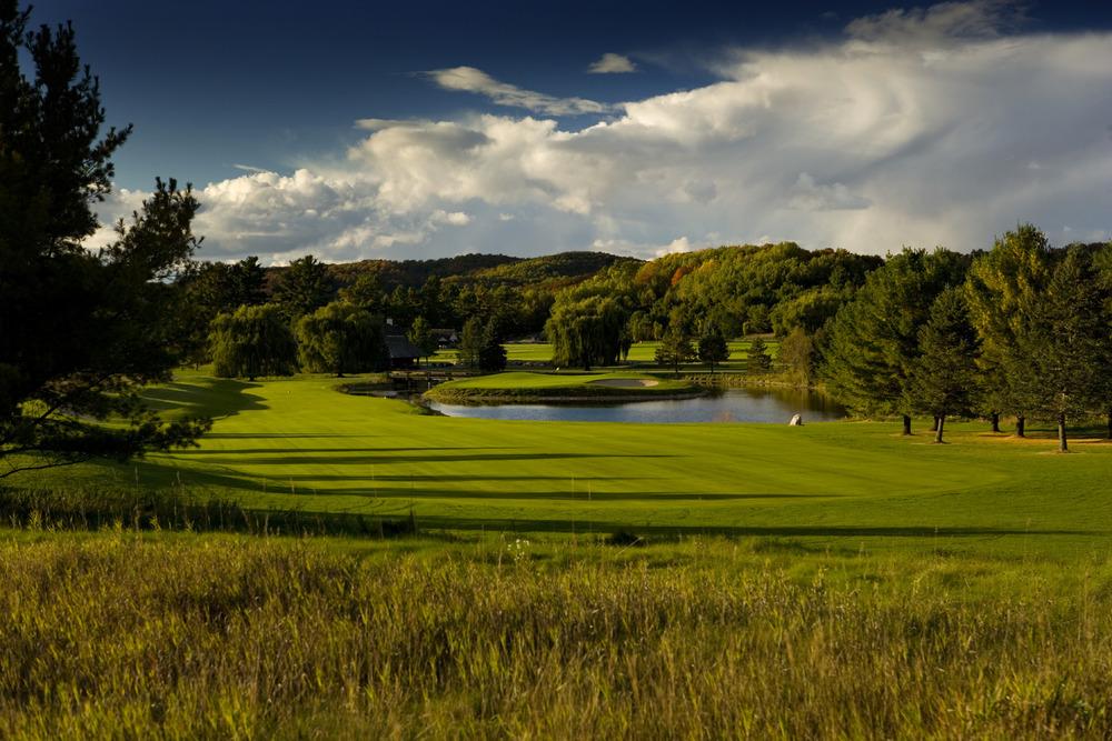 Golf course greens and pond at Boyne Highlands Resort