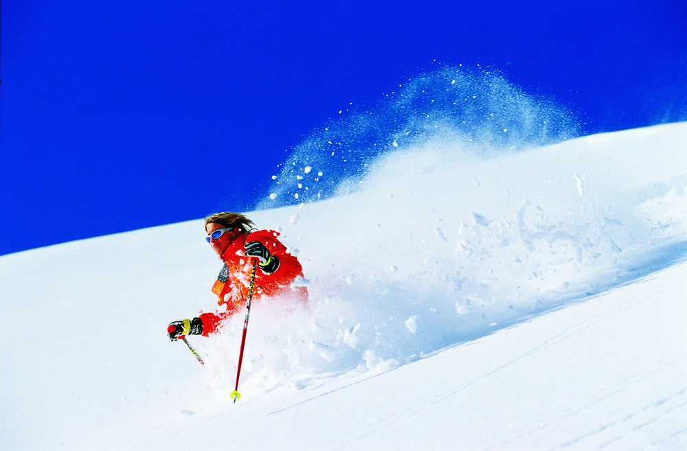 Skier in thick powder at Hochfugen, AUT.